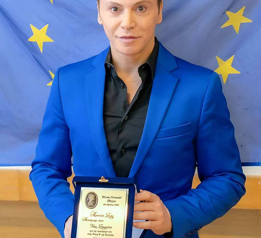 Takis-Zacharatos-a-great-actor-posing-with-his-award-from-women-union-of-patras